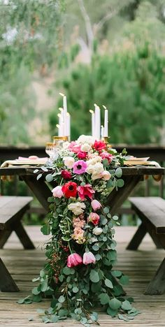 I think a eucalyptus table runner, with florals, and candles along farm tables would be gorgeous! www.lemagnifiqueblog.com