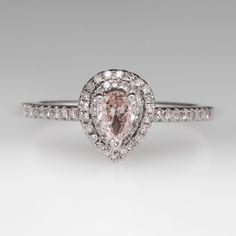 Pear shaped diamond engagement ring.