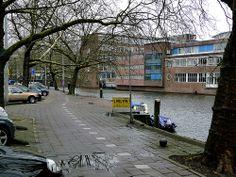 View over empty plane trees along the canal Nassaukade, Amsterdam center; location between district Jordaan and Kinkerbuurt, Amsterdam Oud-West; - urban photography by Fons Heijnsbroek, the Netherlands, 2013