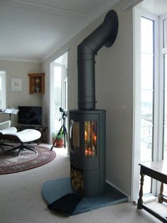 Kernow Fires Contura 850 in black wood burning stove installation in Cornwall. Kernow Fires Contura 850 in black wood burning stove installation in Cornwall. Wood, House, Contemporary Wood Burning Stoves, Home, Home Fireplace, Fireplace Hearth, Fireplace Design, New Homes, Stove