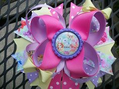 The bow is made with grosgrain ribbons      Bow can be put on french clip or alligator clip with no slip gripper   All ends of ribbons have been heat sealed to prevent fraying of ribbond