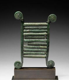 Phoenician Bronze Chalcophone, c. 8th-7th Century BC A musical instrument composed of two vertical bars with spiraled terminals as resonators, with eleven bronze springs coiled around connecting pins.