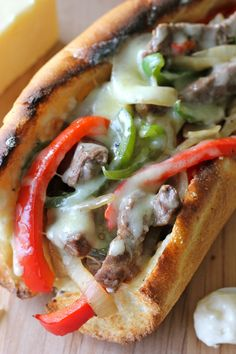 """Philly Cheesesteak with Garlic Aioli - You could EASILY make this right at home without having to skimp on the cheesy, meaty goodness! """"Instead of the Garlic Aioli, but 'Just Mayo' which is much better and healthier. Think Food, I Love Food, Good Food, Yummy Food, Tacos, Tostadas, Great Recipes, Dinner Recipes, Favorite Recipes"""