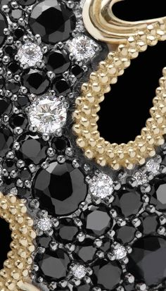 Close up detailed image of the Nightfall collection with faceted black spinel, pavé diamonds and 18k gold. LAGOS Jewelry