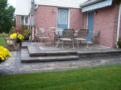 Backyard patio retaining wall with integrated steps
