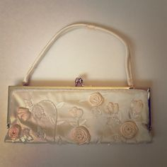 Clutch bag Size is small. It's pearl color with light pink roses. Bags Clutches & Wristlets