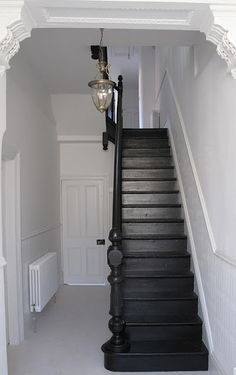 Explore The Best 24 Painted Stairs Ideas for Your New Home : 27 Painted Staircase Ideas Which Make Your Stairs Look New Tags: painted staircase, painted plywood stairs, painted stairs black, painted stairs ideas pictures Black Painted Stairs, Black Stairs, Black Banister, Black Hallway, Painted Floors, Dark Staircase, Staircase Design, Staircase Ideas, Staircase Remodel