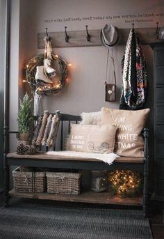Love this rustic Christmas mud room decor.