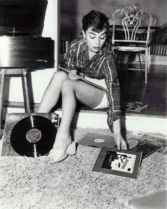 Audrey Hepburn with records. #celebrityaudio #music #celebrity http://www.pinterest.com/TheHitman14/celebrity-audio-%2B/