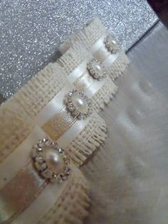 Do-it-yourself Napkin Rings- light tan burlap, wide cream satin ribbon, narrow tan/beige satin ribbon to match burlap, glue rhinestine pearl.like to do in teal /turquoise burlap with matching narrow satin ribbon