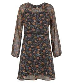 """Anita and Green. Team this floral print long sleeve dress with block heel ankle boots - great for wearing from day to night.- All over floral print- Rounded neckline- Simple long sleeves- Ladder lace trim- Casual fit- Mini length- Model is 5'8""""/176cm and wears UK 10/EU 38/US 6"""