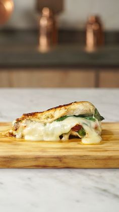 Literally stuff your chicken with flavor by filling it with sun-dried tomatoes, mozzarella cheese, and spinach.