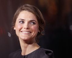 Pin for Later: Keri Russell's Most Stunning Snaps From 1999 to Now 2010 She gave a sweet smile at the LA premiere of Extraordinary Measures in 2010.