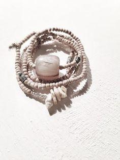 Image of wood and dark turquoise bracelet