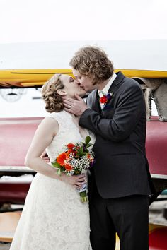 outdoor wedding // Madison, WI // outdoor wedding ceremony // kissing bride and groom