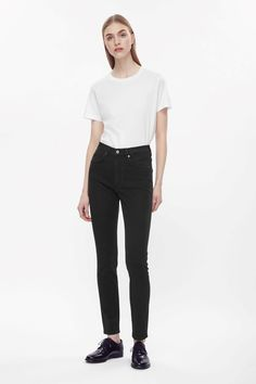 Made from washed stretchy black denim, these slim fit cropped jeans are cut to sit high on the waist. A five-pocket style they have a classic zip fly.