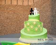 Green puzzle piece wedding cake by Edible Art of Raleigh. Raleigh weddings. Neil Boyd Photography.