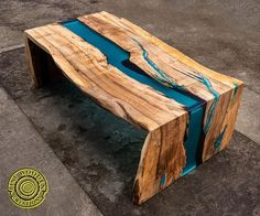 Double waterfall Live Edge River Coffee Table with glowing turquoise resin. River flows through tale top and then turns to the legs going down. It has a turquoise + emerald resin river flowing between wood pieces. MADE TO ORDER. YOU CAN CONFIGURE YOUR OWN TABLE, BENCH AND COFFEE TABLE WITH OUR Wood Resin Table, Wooden Table Top, A Table, Dining Table, Dining Room, Turquoise Color, Wood Table Design, Wood Stool, Wood Benches