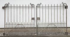 A pair of wrought iron gates,19th century,each gate 144cm wide x 164cm high (2)