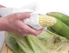 To remove corn silk from corn on the cob, dampen a paper towel (or terry cloth) and brush downward on the cob. Every bit of corn silk should come off.