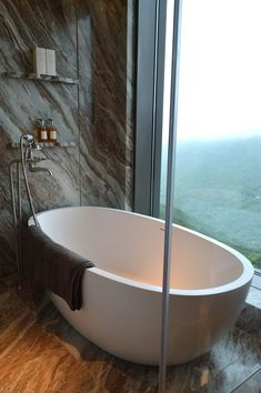 Bathe with a view - a  customized free standing Ellipse bath