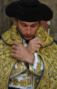 Bullfighter, before going outside to bullring, concentrated...praying