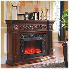 """Don't need at the moment, but maybe will one day.  62"""" Grand Cherry Electric Fireplace at Big Lots."""