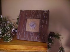 Wooden Snowflake Picture ~ Michaels Crafts has these unfinished wood frames in the dollar bin.  I did a crackle finish on the frame, printed a primitive looking snowflake on a paper bag.  Perfect decoration to leave out all winter season.