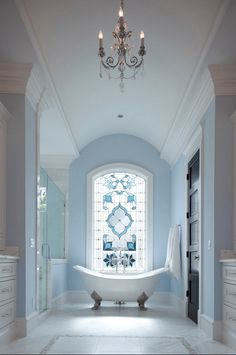 powder blue and white classic bathroom, claw foot tub, freestanding tub, stained glass window, pantone airy blue, sky blue, baby blue, light blue, powder blue
