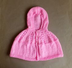 Ravelry: Carla - Hooded Baby Cape pattern by marianna mel Knitted Cape Pattern, Baby Cardigan Knitting Pattern Free, Baby Poncho, Baby Sweater Patterns, Knit Baby Sweaters, Knitted Poncho, Baby Knitting Patterns, Baby Patterns, Baby Knits