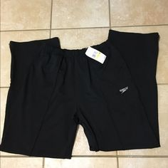 PRICE $25 SPEEDO TRAINING   PANTS SPEEDO BLACK KNIT PANTS WITH WIDE ELASTIC WAISTBAND WITH DRAWSTRING N SIDE POCKETS WITH 7 INCH ZIPPER AT BOTTOM OF LEGS...NEW WITH TAGS $66 MEN SIZE MEDIUM Speedo Pants Sweatpants & Joggers