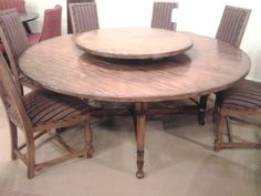 "72"" lazy susan table by Lloyd Buxton"
