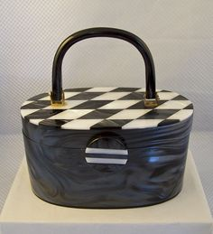 lucite purse with checkerboard inlay