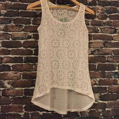 ⚓️Floral High-Low Tank in White⚓️ 100% Polyester with rhinestone embellishment on the front. Dry Clean Only. This tank is adorable, pictures don't do it justice! Available in S,M and L. Also available in Mint, Pink and White. Could be used as a bathing suit cover-up or dressed up for a night on the town. Tops Tank Tops