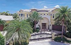 Single Family, WF/Pool/Ocean Access - Lighthouse Point, FL A one of a kind, Point lot home with Mediterranean Architecture and elegant d??cor throughout. 5 Bedrooms + office, media room, grand scale living room with soaring volume ceilings, fireplace, triple salt water aquarium. Formal dining room with wine cellar, deluxe kitchen with top of the line stainless steel appliances, Master suite with sitting area & large balcony, elevator, outdoor kitchen with fireplace, cabana bath, resort…