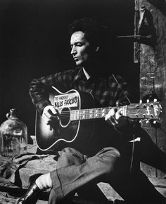 """Woody Guthrie """"If you walk across my camera I will flash the world your story."""""""