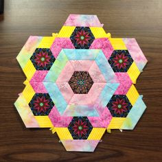 Katja Marek's The New Hexagon - Millefiore Quilt-Along: Rosette 2: Round 1 done. By Tracy Pierceall, 2/5/2015