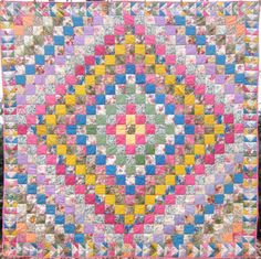 Trip around the world    This pretty 1930's quilt is all cotton sateens.