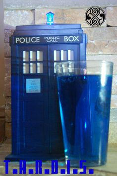 TARDIS blue drink T.A.R.D.I.S.:  1oz - Blue Curacao, 1oz - Black Cherry Rum, 1oz - Grape Pucker, 0.5 oz Captain Morgan, 0.5 oz Simple syrup, Sprite   Shake all alcohol in a mixer with ice.  Pour in a highball or pint glass over ice.  Fill with Sprite, add in the simple syrup.  Mix lightly.  ALLONS-Y!!!!!!