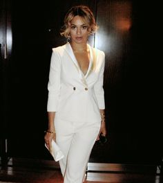 Beyonce wearing our ARC BANGLE in Gold!!  { Left Wrist }