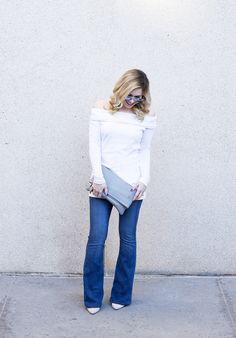 https://1xbru22lnl6y2sc1s11obynp-wpengine.netdna-ssl.com/wp-content/uploads/2016/02/three-dot-off-the-shoulder-top-gigi-new-york-clutch-frame-denim-flared-jeans.jpg?resolution=1024,1