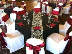 wedding themes in black and dark red | Black table cloths with burgundy napkins, water goblet, champagne ...