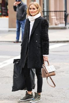 Olivia Palermo wearing Tibi Black Faux Astrakan Wool Double Breasted Long Vest and Max&Co Canvas Trainers in Khaki Green