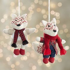 Chevron-patterned fox ornaments pair up in their finest warm woolens. Lucy wraps a checked muffler over her taupe and cream ensemble, while George dons a plain red warp over his checked jacket and jeans.