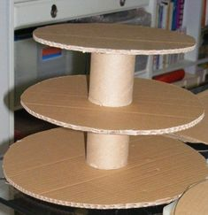 """DIY Cupcake Stand (I'm thinking covered cans for the """"poles"""") But what to use for the base..."""