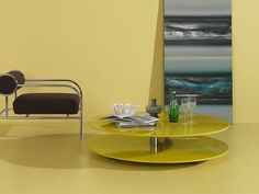 Low #coffeetable made by two MDF tops, available in all the lacquered colours, with a steel bridge. By @cappellininext