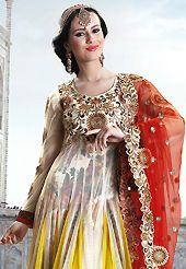Dreamy variation on shape and forms compliment your style with tradition. The dazzling off white and yellow net anarkali churidar suit have amazing embroidery patch work is done with resham, zari, sequins, stone and cutbeads work. Beautiful embroidery work on kameez is stunning. The entire ensemble makes an excellent wear. Matching santoon churidar and red net dupatta is available with this suit. Slight Color variations are possible due to differing screen and photograph resolutions.