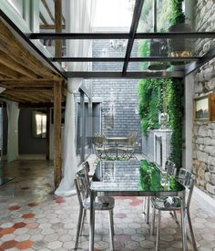 """""""The glass floor emerged as a way to visually interconnect the different spaces. It makes the living room feel twice as tall, and from the inside of the apartment on either floor you can look up and see the sky (very rare in Paris)."""""""