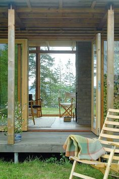 YES - vertical beams, wood slats, sliding glass doors, line of sight, circulating air and light, materials, light, indoor/outdoor