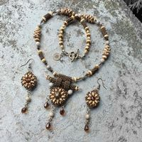 Necklace and earrings set by Gianelle.